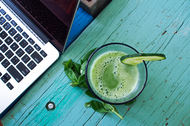 Morning juice next to Macbook